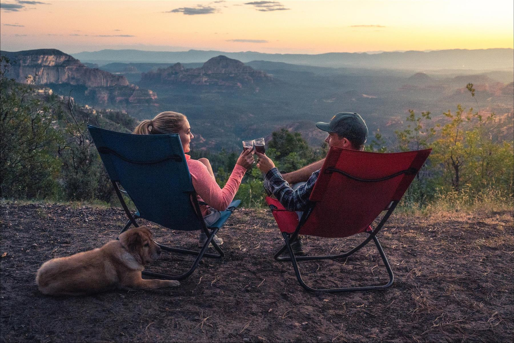two people in camping chairs